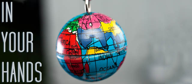 Macro of tiny Earth globe hanging on key chain